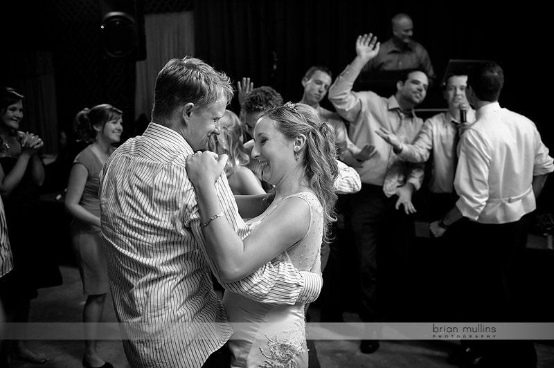 groom serenading bride