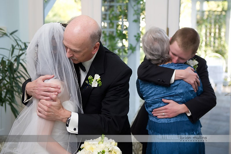 family congratulating bride and groom