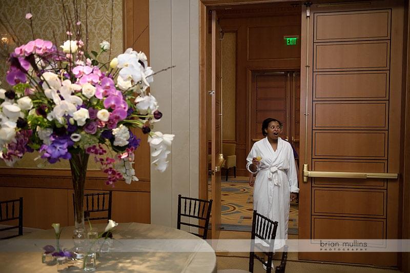 bride sees wedding reception room