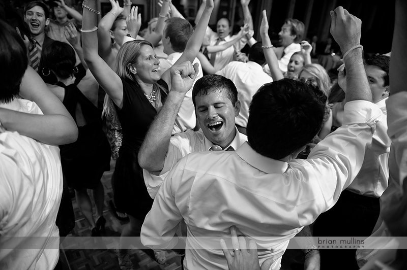 groom getting mobbed at wedding reception