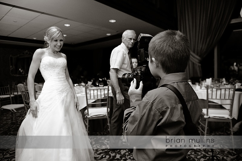 wedding guest with wedding photographers camera