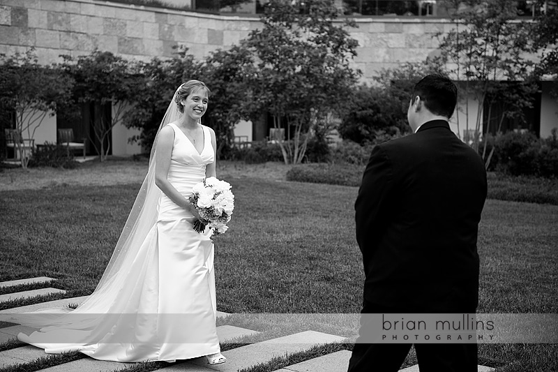 bride and groom see each other at wedding