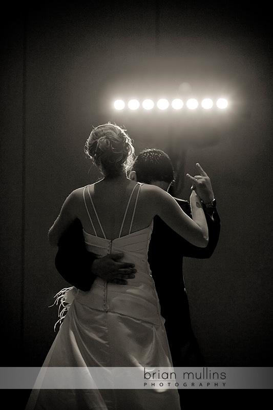 groom gives devil horns at wedding reception