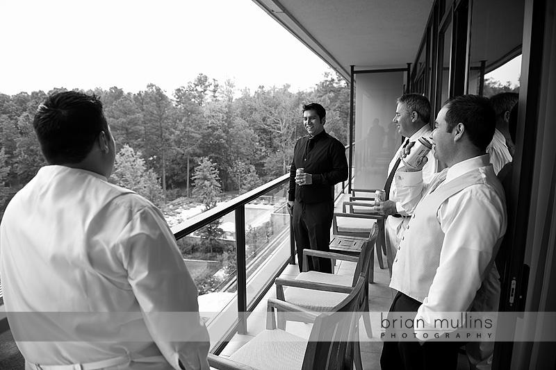 groomsmen on Umstead Hotel balcony