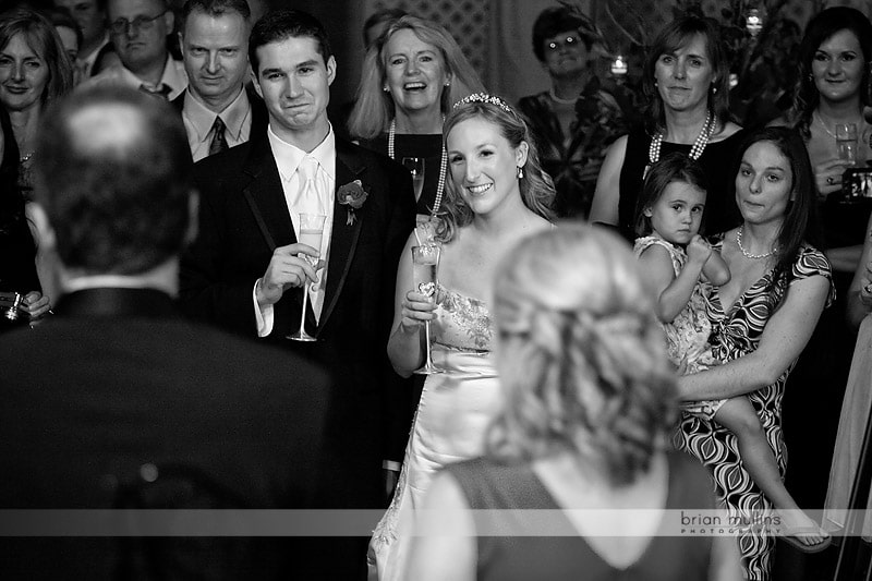 father toasting bride and groom