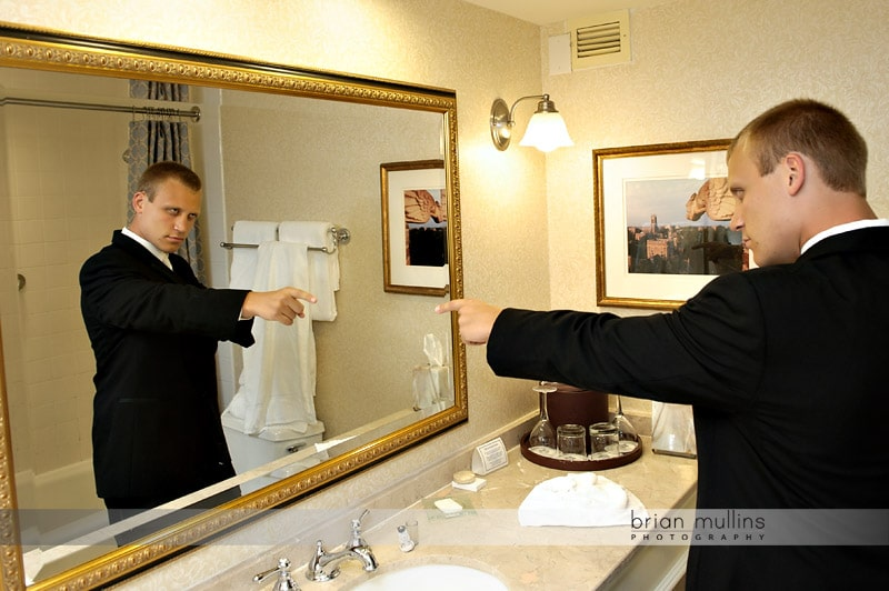 groom getting pumped up for wedding