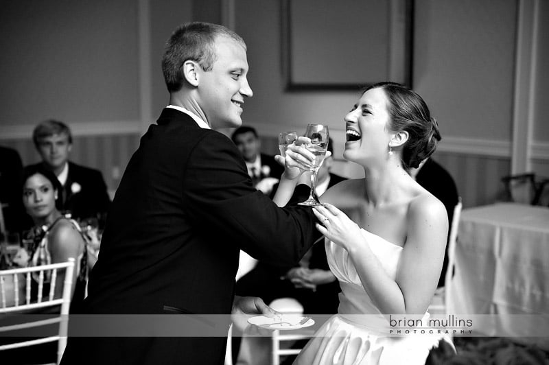 champagne toast with bride and groom