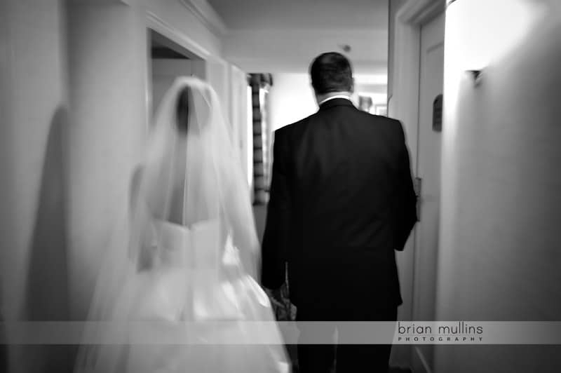 bride walking with father before wedding