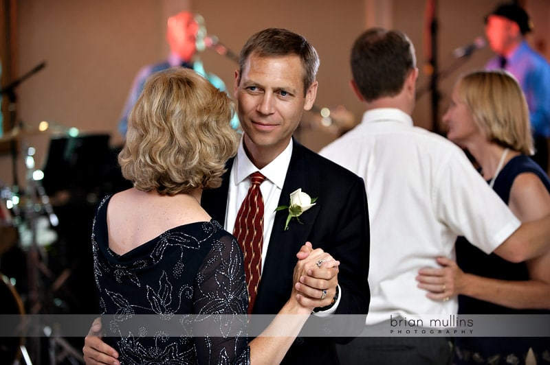 grooms parents dancing at wedding reception