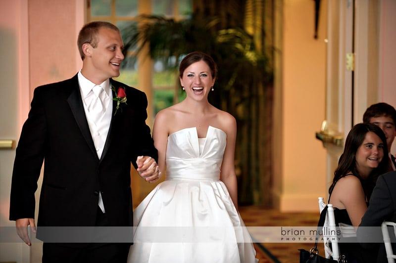 bride and groom walking into wedding reception
