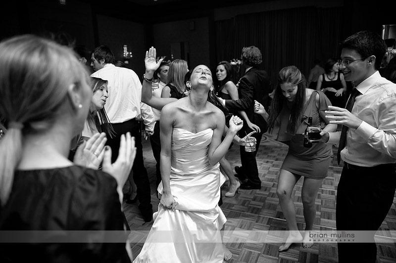 bride singing at wedding reception