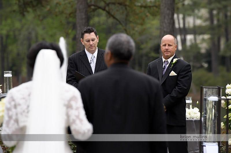 groom sees bride walkingn down the aisle