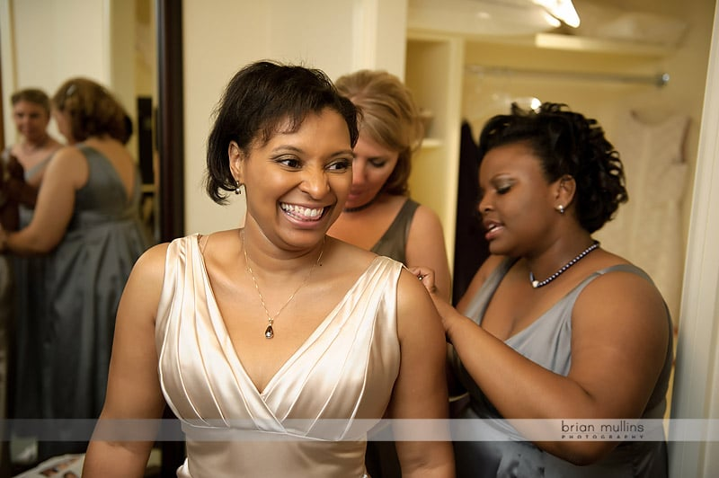bride changing wedding dress