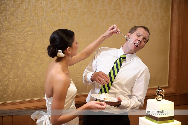 wedding cake smashed into grooms face