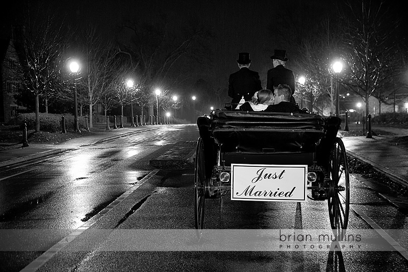 bride & groom kiss in a horse & carriage