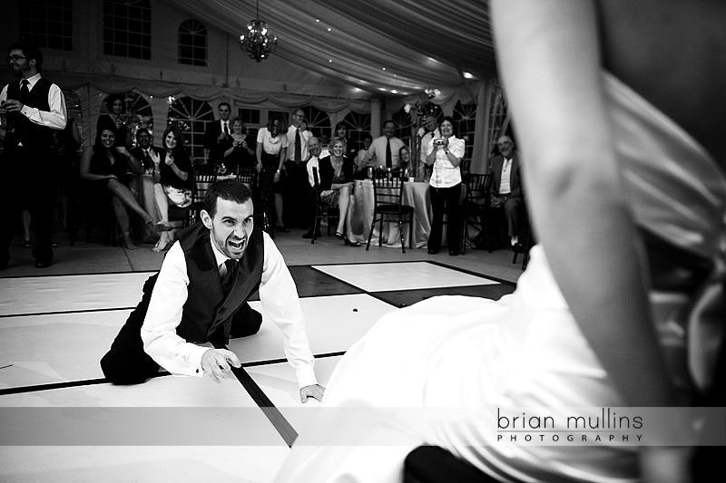 funny groom garter removal - Raleigh Wedding Photographer