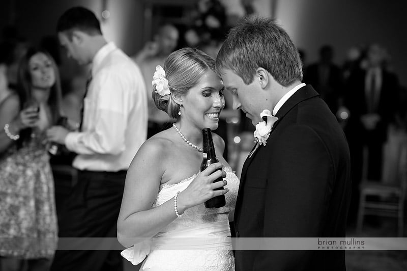 bride and groom share a tender moment