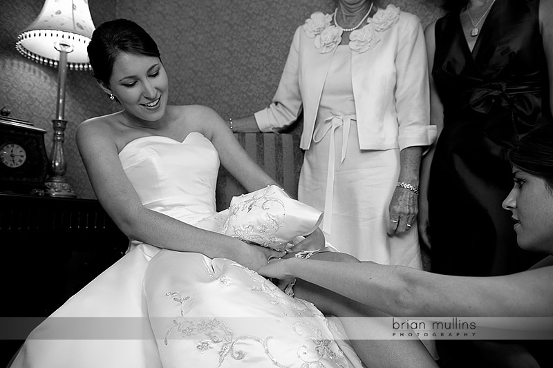 bride putting on garter