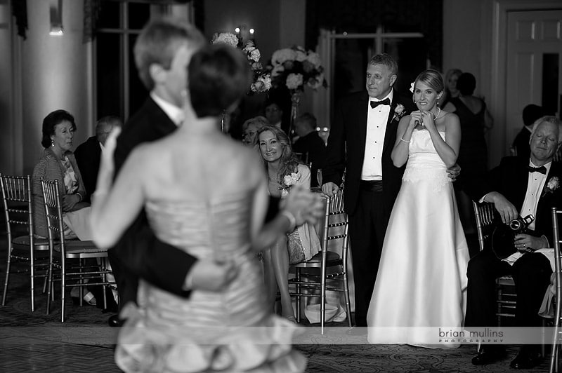 bride crying during parents dance