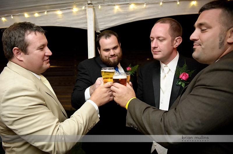 groom toasting at wedding