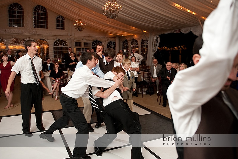 funny groom garter toss - Raleigh Wedding Photographer