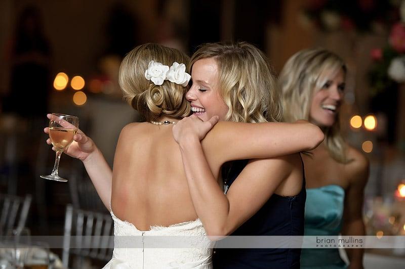 bride hugging friends at reception