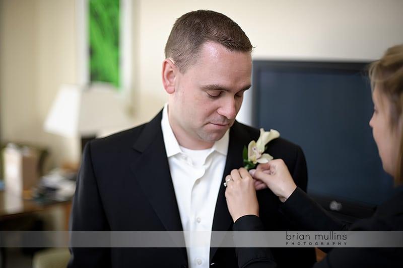 groom getting ready for umstead hotel wedding