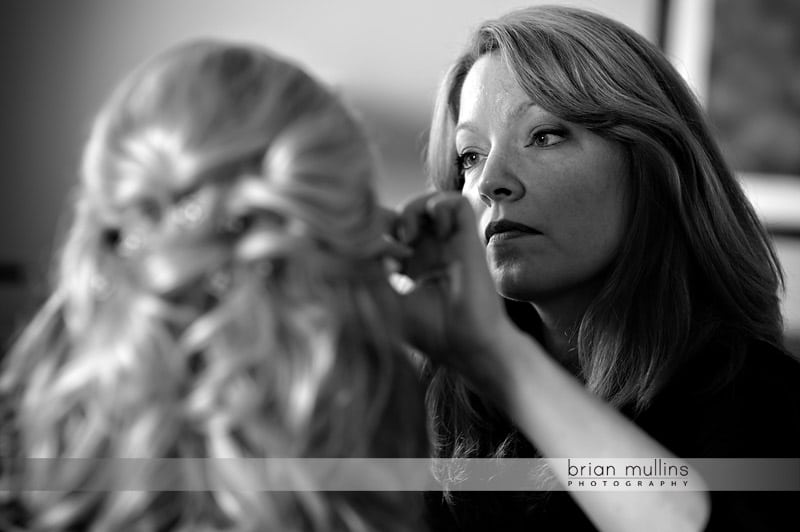 bride getting hair and makeup