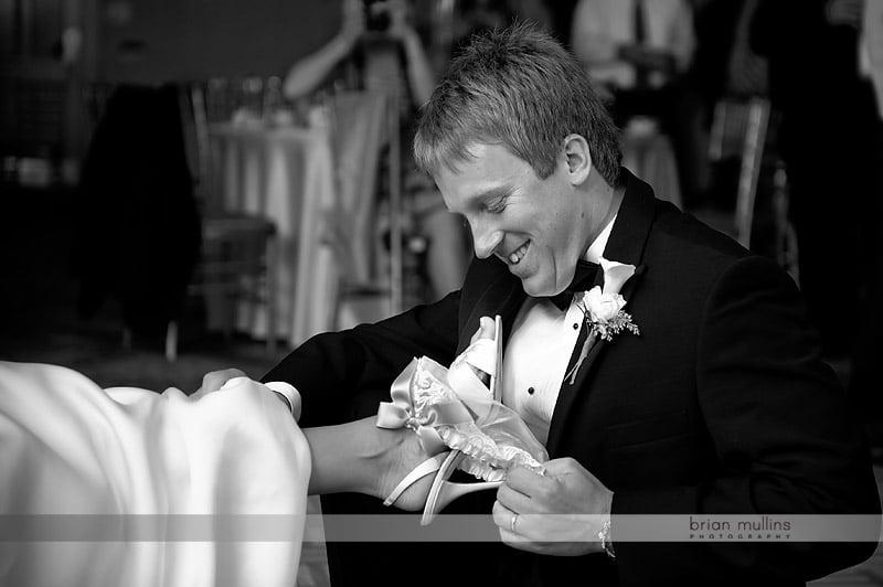 groom pulling off brides garter