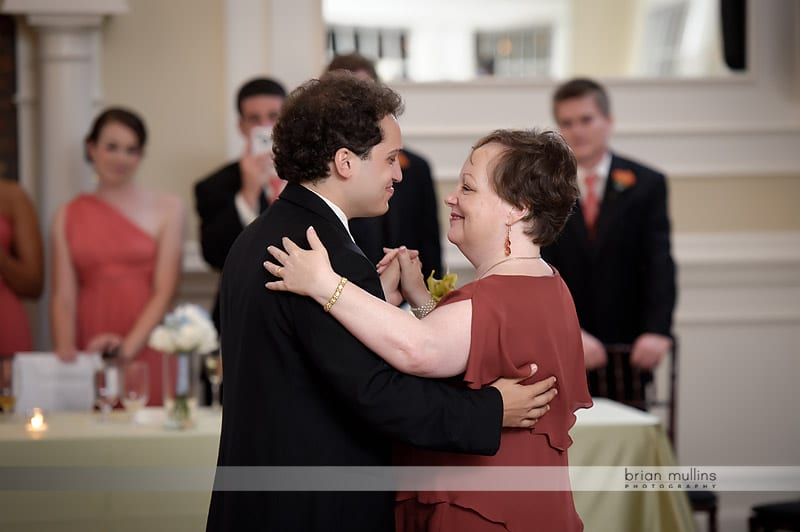 mom dancing with groom