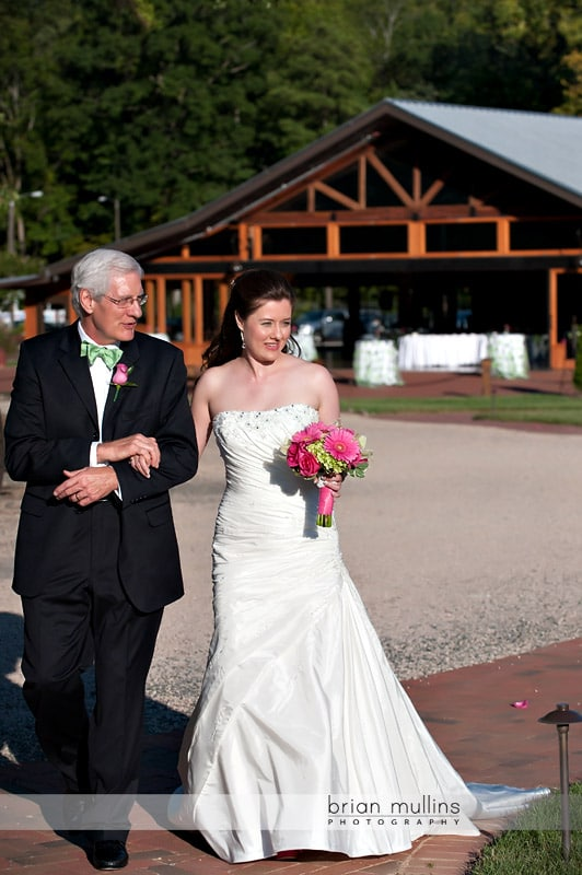 bride walking with father at wedding