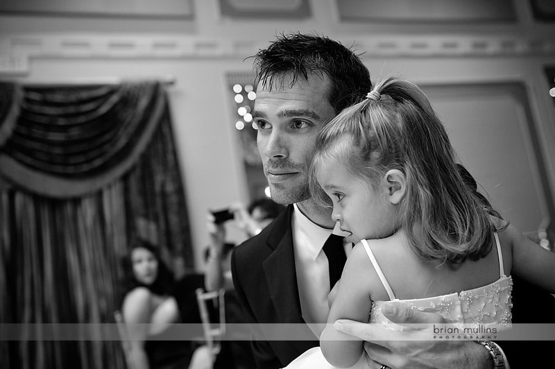 groom watching father daughter dance