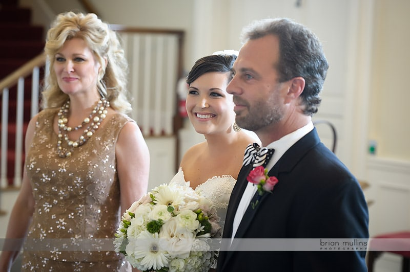 bride with parents before wedding