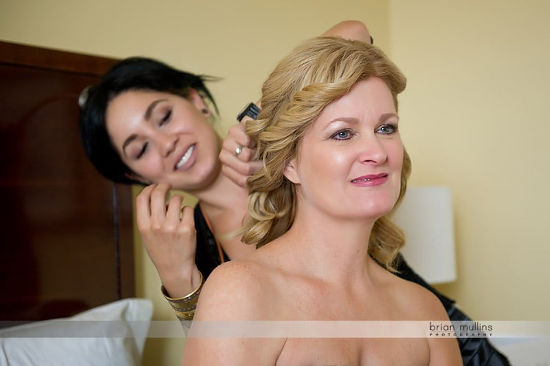 mother getting her hair done for wedding