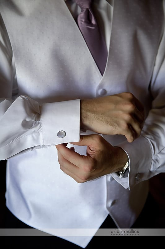 details of groom getting ready