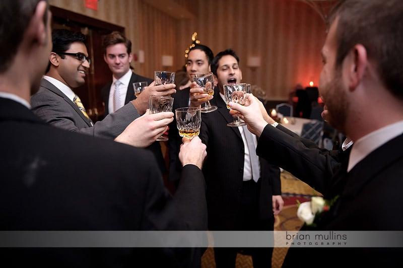 guys toasting at wedding