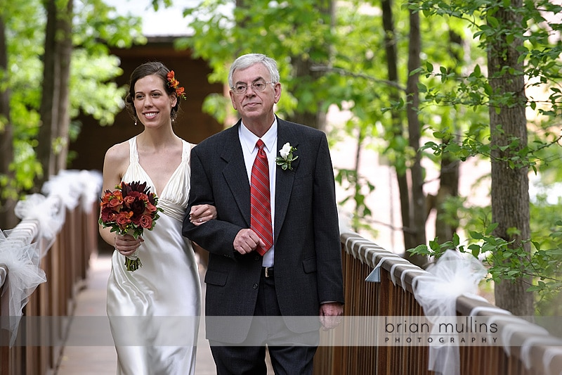 bride walks with dad to wedding ceremony
