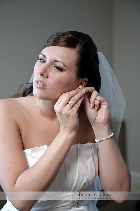 bride putting on earring