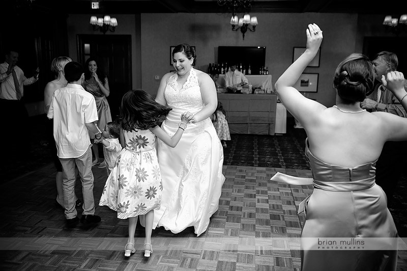 bride dancing with kids at wedding reception