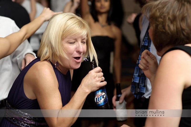 singing into beer bottle