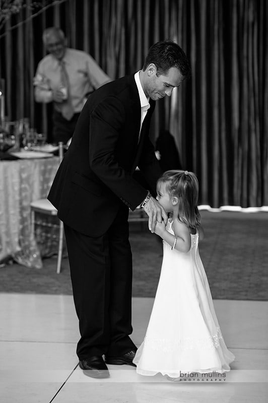 groom dances with young daughter