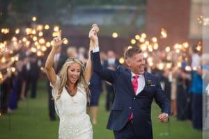 bridge and groom exiting their wedding thru sparklers
