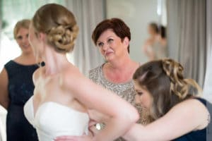 Mother helping the bride get ready for her wedding ceremony at the highgrove