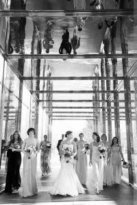 bride walking with bridesmaids at north carolina museum of art wedding