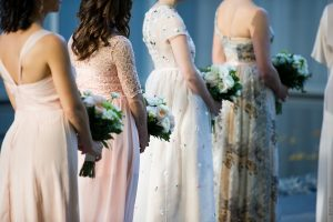 bridesmaids holding bouquets at wedding