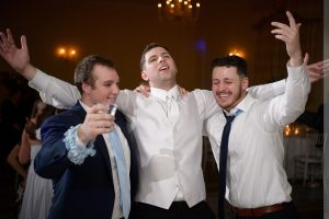 groom singing at wedding reception
